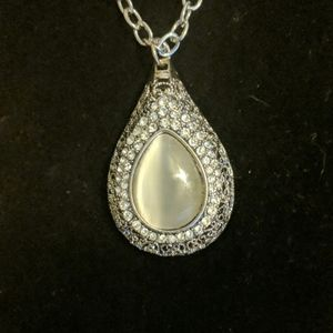 Large grey and silver tone pendant with crystals